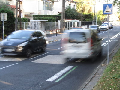 Car speeding on cycleway lane