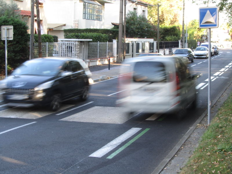 File:Car speding on cycleway lane.jpg
