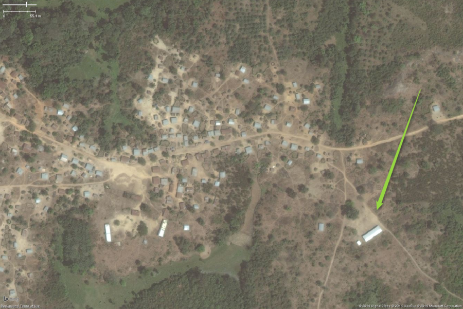 A typical rural school in West Africa. This zoomed out view shows a likely school on the eastern edge of the village. Please note the two long buildings on the western side of the image could easily be confused for school areas, but the lack of a large clear yard and toilet buildings suggests they are not schools. The overall school property should be tagged with amenity=school.