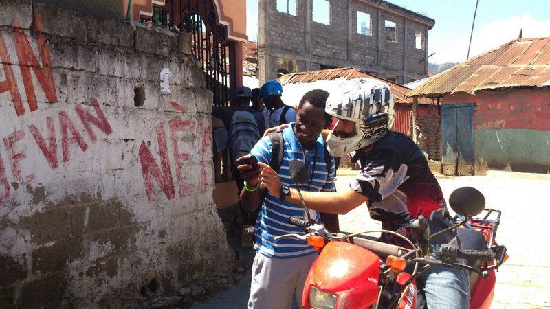 File:Wolf Moto Team With Helmet Camera HOT Cap Haitien Haiti.jpg