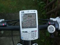 PTGMAP oms ipaq on bike.JPG
