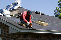 FEMA - 44634 - Roofer working on a home in Oklahoma.jpg