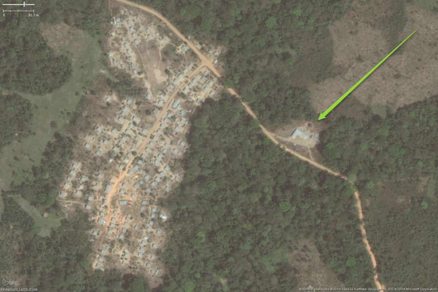 A typical rural school in West Africa. This zoomed out view shows a likely school on the eastern side of the village. While the buildings are not the very classic two long buildings, the overall placement helps to determine this is a school as will the detailed views below. The overall school property should be tagged with amenity=school and I would also put fixme=confirm on this one as well.