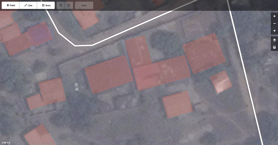 Typical buildings in West African city mapped correctly displayed in the iD web browser OSM editor.