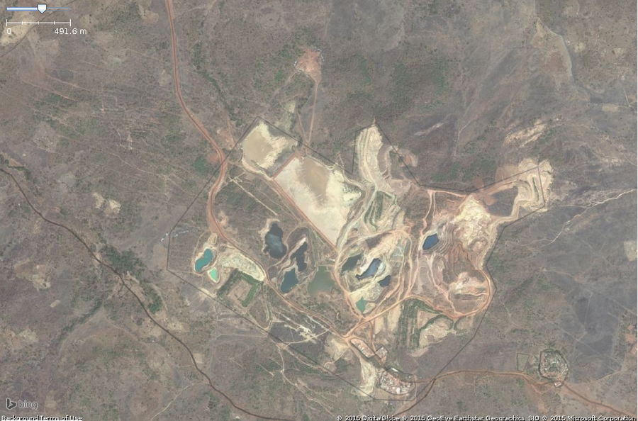 A typical site of surface mining in west africa. This zoomed in view shows the key features: pools of ground,funny color,exposed ground.The overall area should be tagged with landuse=quarry.