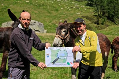 "Two people (and some donkeys) at the ""Dal gps alla montagna"" Mapping Party, an event in the mountains of Trentino, Italy."