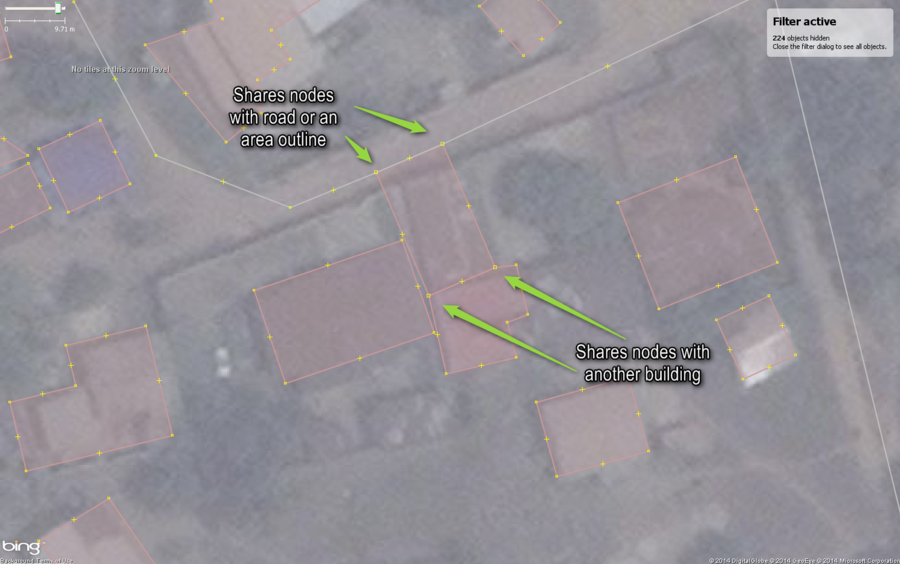 Typical buildings in West African city mapped with a common mistake, shared nodes with some annotations.