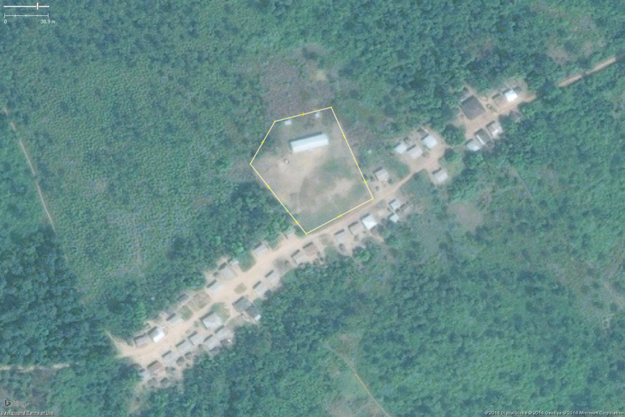 A typical rural school in West Africa. This zoomed in view shows the key features: 1 or 2 long buildings, 1 or 2 smaller toilet buildings, a large bare field. The overall school property should be tagged with amenity=school and the buildings with building=yes.