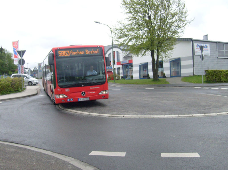 File:Mini-Roundabout Aachen with Bus.jpg