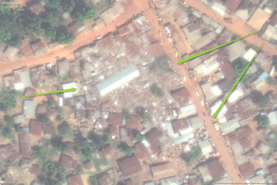 A likely marketplace in a large West African town. The key features are the small buildings tightly packed. In this example a rather large area is so densely packed with stalls the roofs appear to touch and overlap each other, covering almost an entire city block. The large building in the middle is probably a storage and distribution building. You can also see the stalls get slightly less densely packed in the areas and side streets around the main marketplace. The collection of small buildings should be tagged amenity=marketplace and fixme=confirm (unless you have first hand knowledge it is a marketplace).