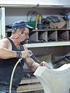 Fr Adamswiller Stone sculptor at work.jpg