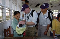 US Navy 050411-N-8629M-049 Non-governmental organization Project HOPE volunteers Andrew Garrett, MD, center, and Michael Polifka, MD, examine an Indonesian child.jpg