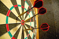 Darts in a dartboard.jpg